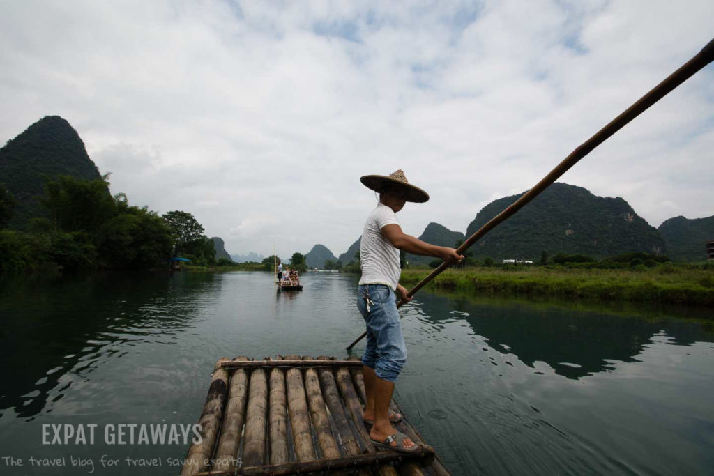 Cruising down the river on a bamboo raft in Yangshou, Guangxi