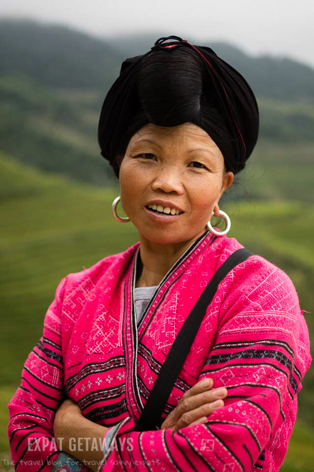 A local Yao woman poses for a photograph. Longji, Guilin