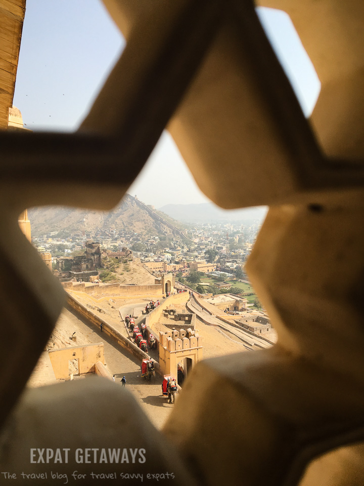 Looking through a star window at the Amber Fort. Expat Getaways, 5 Nights Golden Triangle, Delhi, Jaipur & Agra, India.
